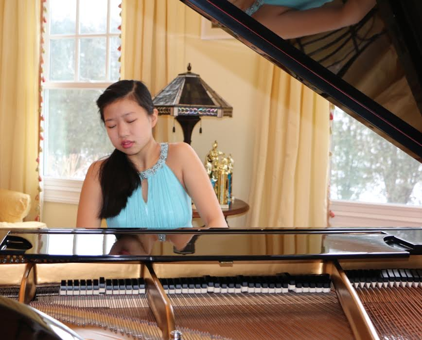 Kimie Han plays piano. Photo courtesy of the Han family.