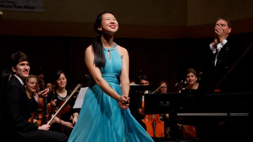 Kimie Han takes a bow after a performance. Photo courtesy of the Han family.