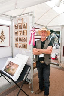 Rudy De Ran stands by his booth at the 2015 Art Fair on the Square at Market Square in Lake Forest. Photo courtesy of Rob Kuehnle.