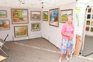 Jacqui Blatchford of Lake Forest stands in her both at last year's show. Photo courtesy of Rob Kuehnle.
