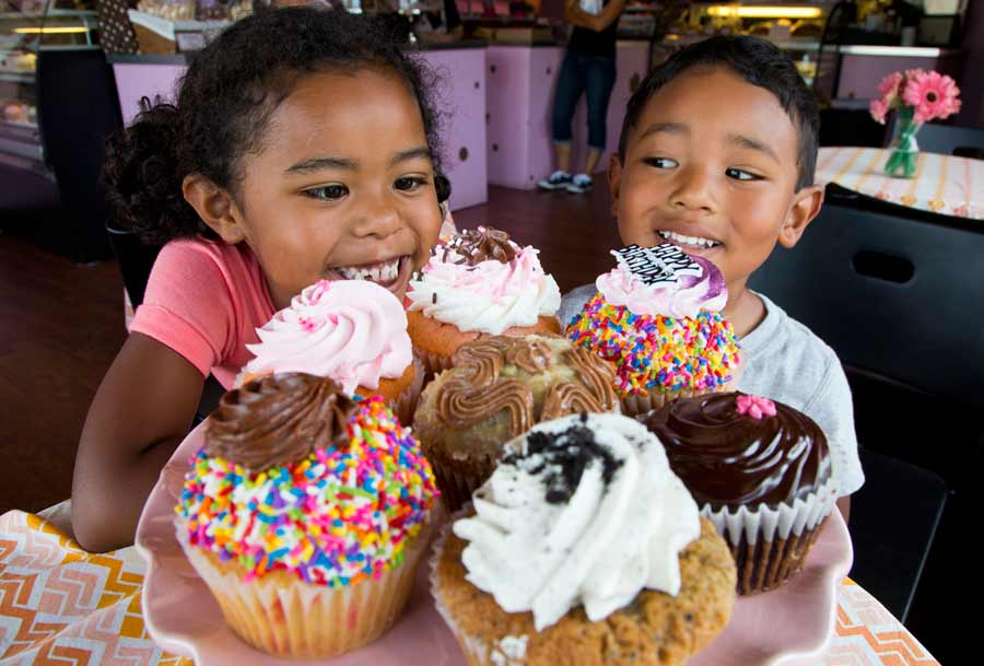 Siblings Ako, 5, and Toshi, 3, Smith of Evanston are mesmerized by cupcakes at Laurence Dean Bakery in Wilmette. Photography by Joel Lerner/JWC Media