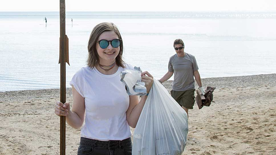 Voluneer has her hands full after beach clean up