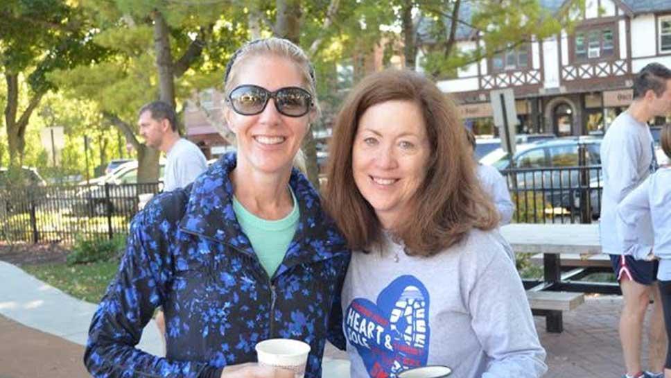Glencoe's Missy O'Bryan and Mary Michelle Scalise enjoy coffee post race.