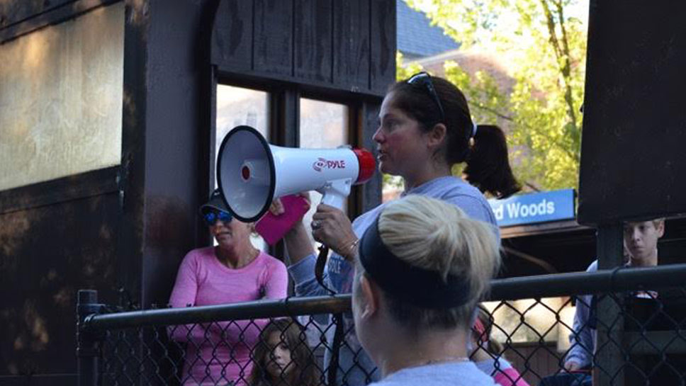 Race organizer, Kerry Farley, of Winnetka, addresses the crowd before the start of the race.