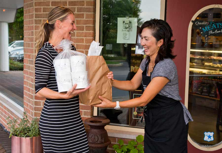 Owner Chikako Jo gives some take out to Jennifer Sollecio of Kenilworth