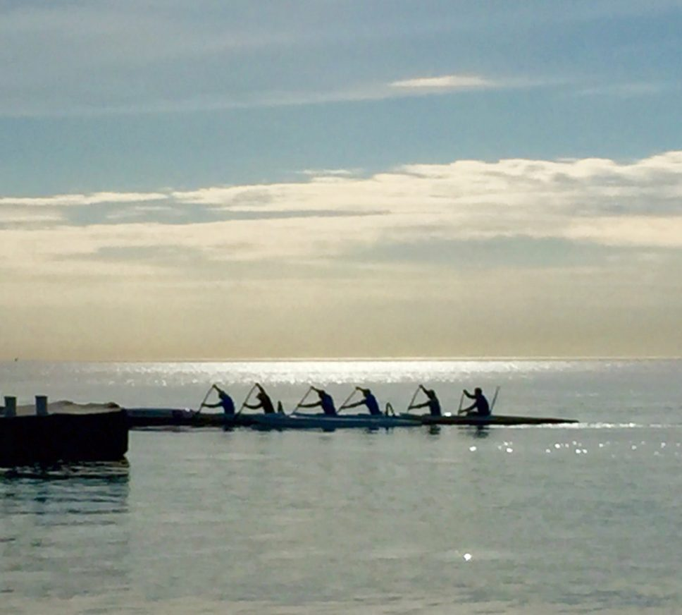 The Outrigger Chicago team heads out from the Highland Park Yacht Club during an evening practice.