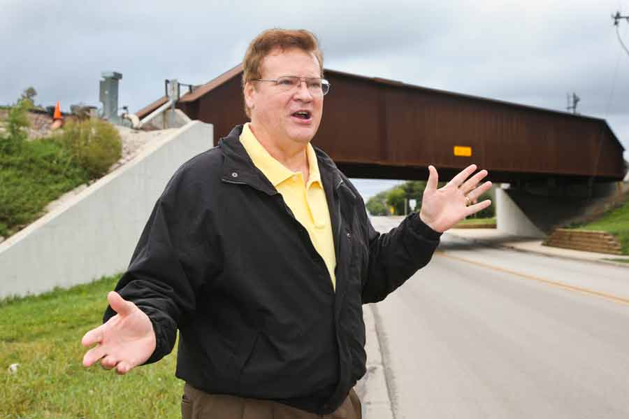 Don Owen, Glenview's deputy village manager, by the bridge on Shermer by Willow, explains the situation with the train parking third track. Photography by Joel Lerner/JWC Media
