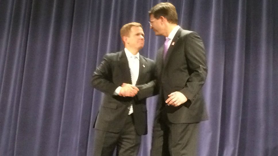 Rep. Robert Dold (R-Kenilworth) and former Rep. Brad Schneider (D-Deerfield) shake hands after their debate October 20 at Glenbrook South High School in Glenview.