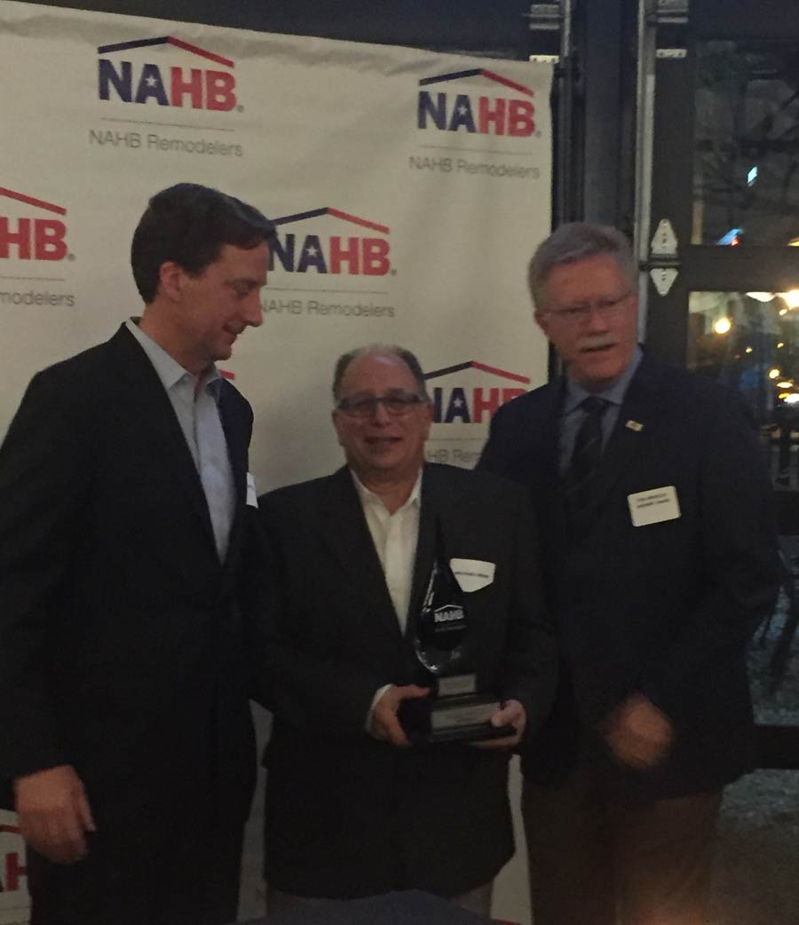 From left, Patrick O'Toole, publisher and co-sponsor of the National Remodeler of The Year Award; Michael Menn; Tim Shigley, chairman of the National Remodelers Council