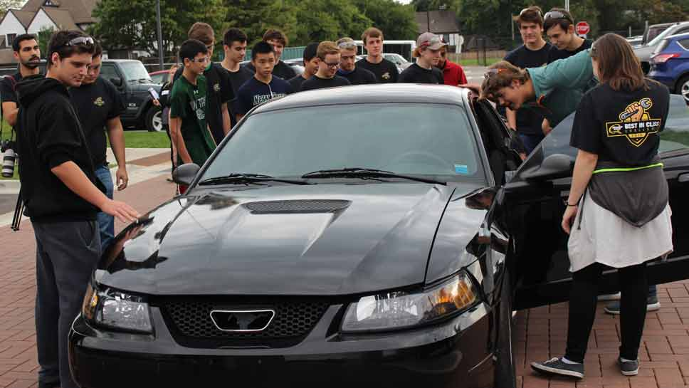New Trier students get ready for the Quaker State Car Challenge