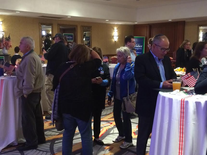 Supporters of former Rep. Brad Schneider (D-Deerfield) await results on election night.