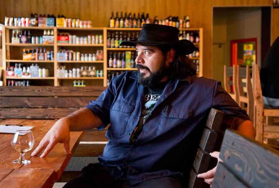 Roy Hernandez, general manager at Art of Beer in Highwood. Photography by Joel Lerner/JWC Media