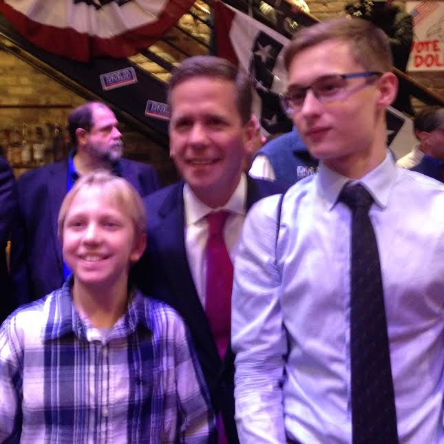 Rep. Robert Dold (R-Kenilworth) stands with young supporters after thanking supporters in Libertyville. Photo by Julie Kemp Pick.