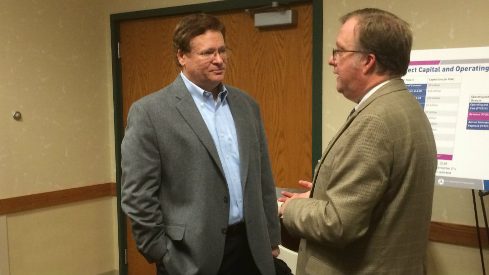 Glenview Deputy Village Manager Don Owen (left) talks to Scott Speegle of the Illinois Department of Transportation during the open house.