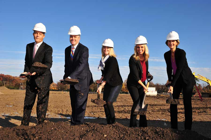 The @properties team scoops a ceremonial first dig at the Kelmscott Park residential property site November 3 morning in Lake Forest.