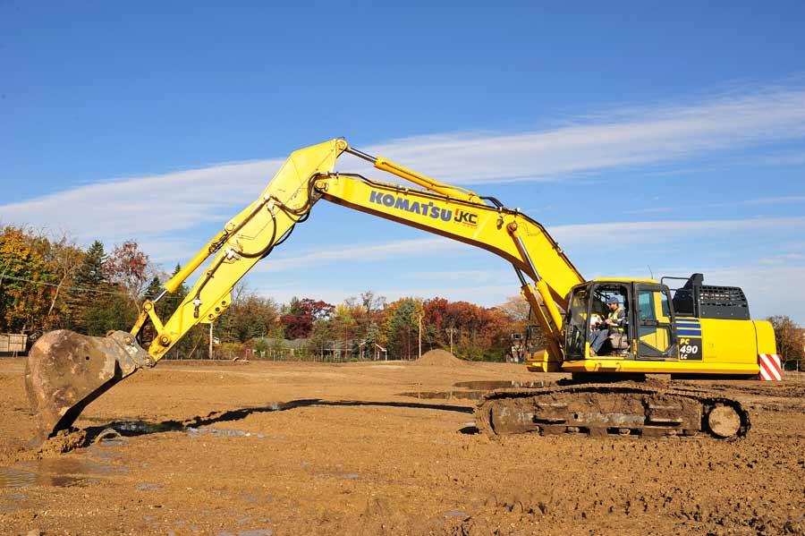 Mike Clark, operating engineer, John Keno and Company Inc., breaks ground on the Kelmscott Park property, Thursday morning in Lake Forest.