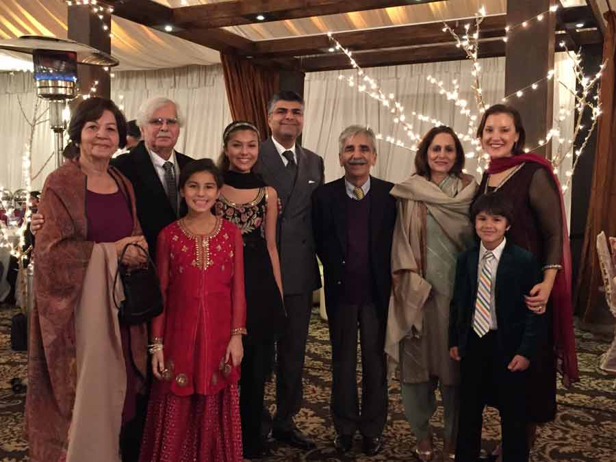 Maliha (fourth from left) and her extended family, including grandparents, aunt and uncle, at a wedding in Pakistan