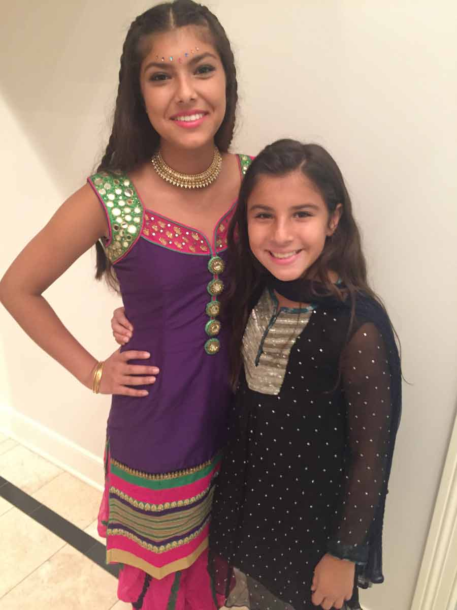 Maliha and her sister, Amani, going to an Eid al Adha party.