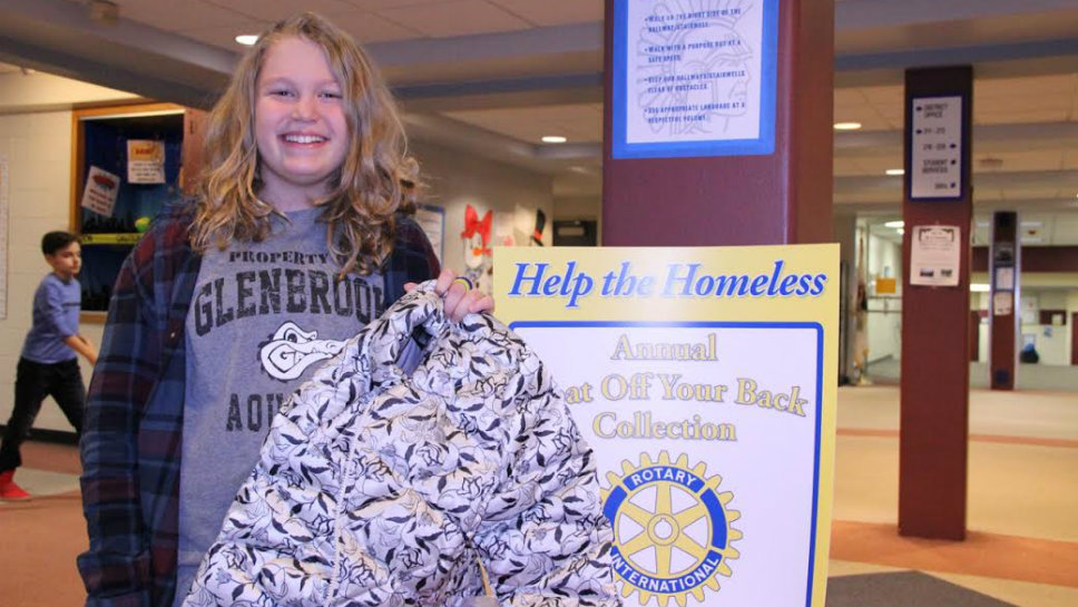 Northbrook Junior High School student Ella Glazer donates a coat to the Rotary coat drive. Photo courtesy of Northbrook School Distreict 28.