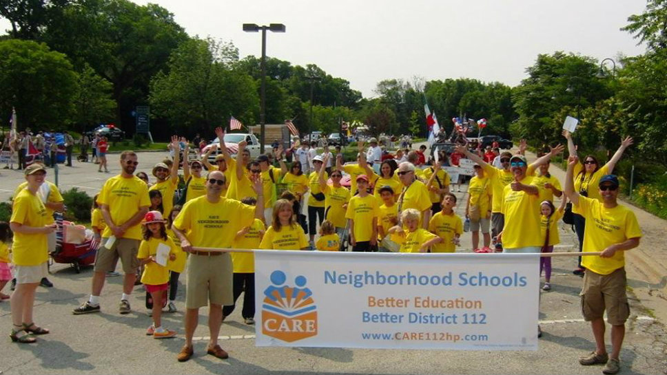 CARE (Citizens Actively Renewing Education) at the July 4th Parade; photo courtesy of Facebook.