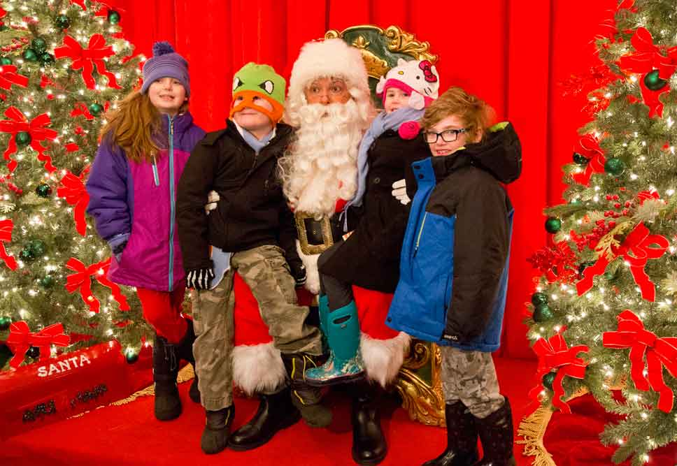Group hug: Santa and Fiona Inkmann, Gus Martin, Lulu Martin, and Baird Inkmann of Lake Forest