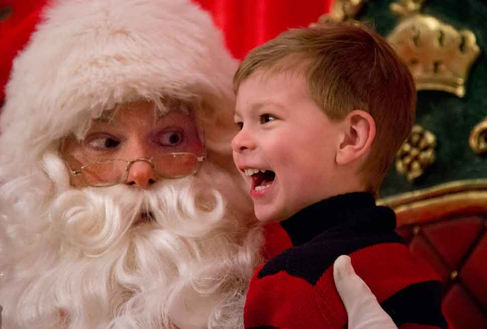 Santa chats with three-and-a-half-year-old Robert Hartman of Lake Forest.