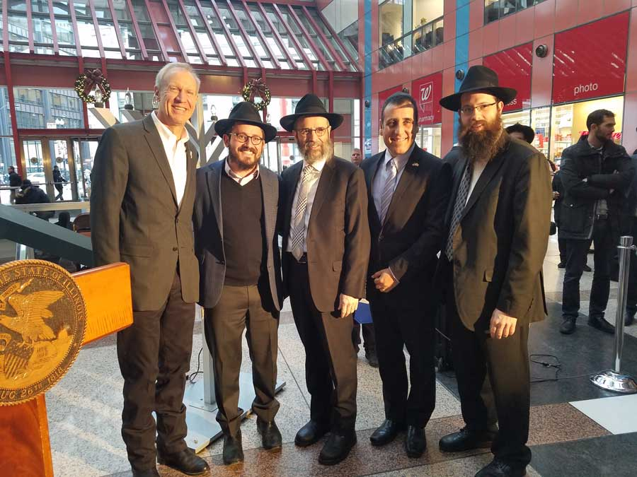 From left, ​Governor Rauner, Rabbi Dovid Flinkenstein, Rabbi Moshe Teldon,​ ​both of Chabad of Wilmette, Consul General of Israel to the Midwest Aviv Ezra, and Rabbi Meir Moscowitz, regional director of Chabad in Illinois.