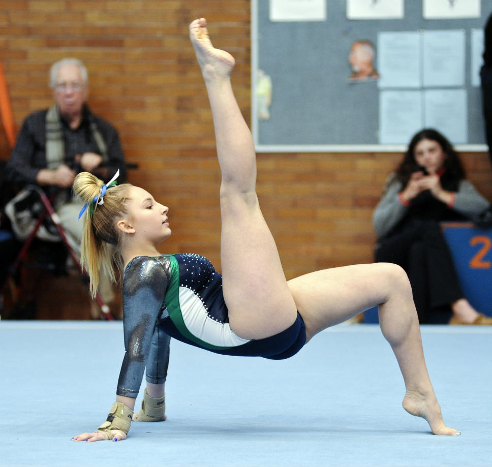 floor gymnastics moves. Avery Faulkner Of The Trevians Moves Through Her Floor Exercise Routine At Evanston Invite. She Took First In Event. PHOTOGRAPHY BY GEORGE PFOERTNER Gymnastics